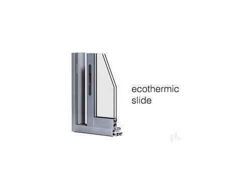 ECOTHERMIC Slide corredera de aluminio.  La serie básica de nuestras correderas. Posibilidad de acristalamiento de hasta 25mm. PRESTACIONES: Aire- 3 / Agua- 7A / Viento- C3 / Ruido- 33dbA. Mejores prestaciones obtenidas: 18 W/mK. Marco de 70mm